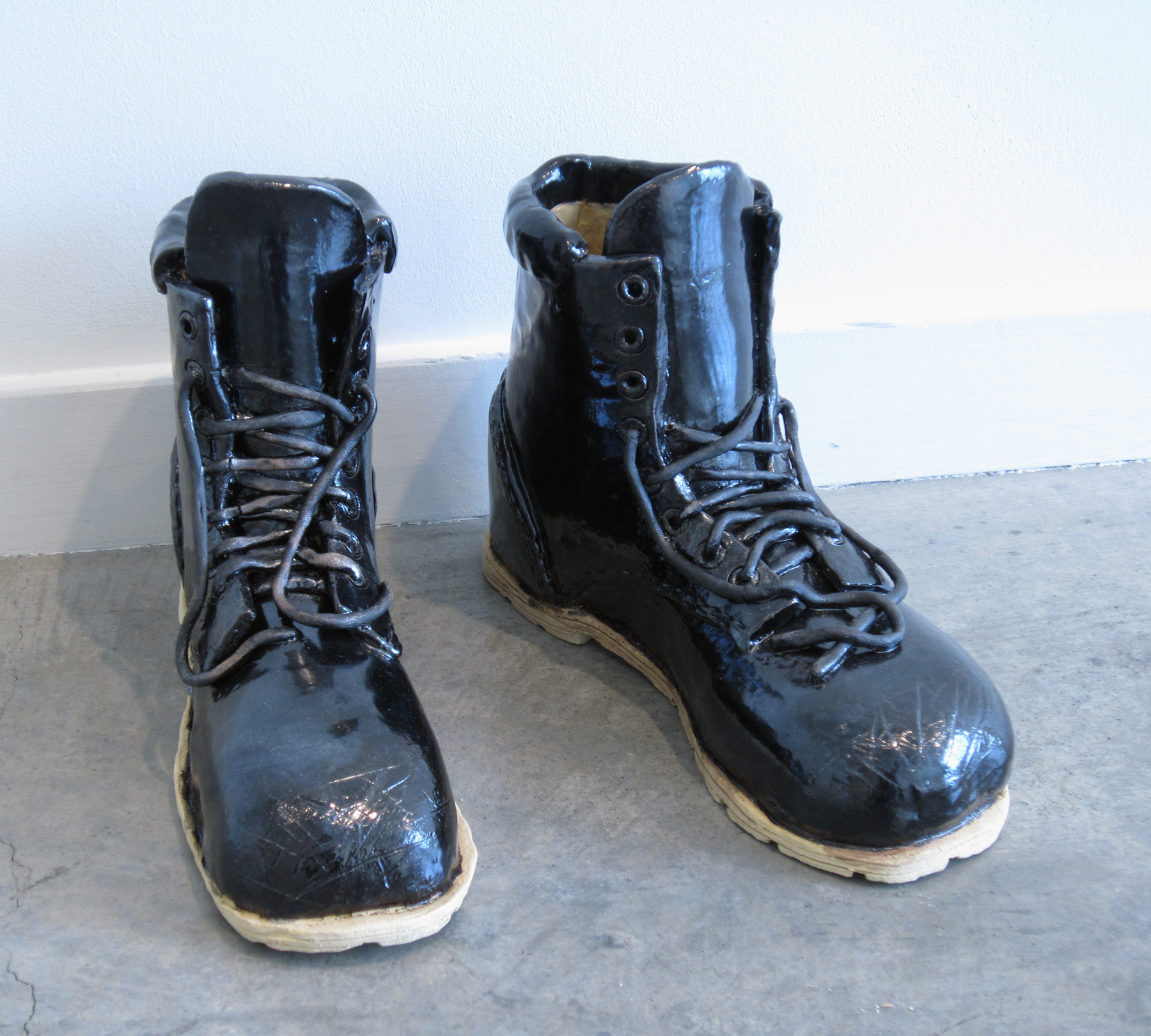"ERIK SCOLLON   Empty Boots,  2013, glaze on stoneware, 9"" x 11 1/2"" x 4"" (each)"
