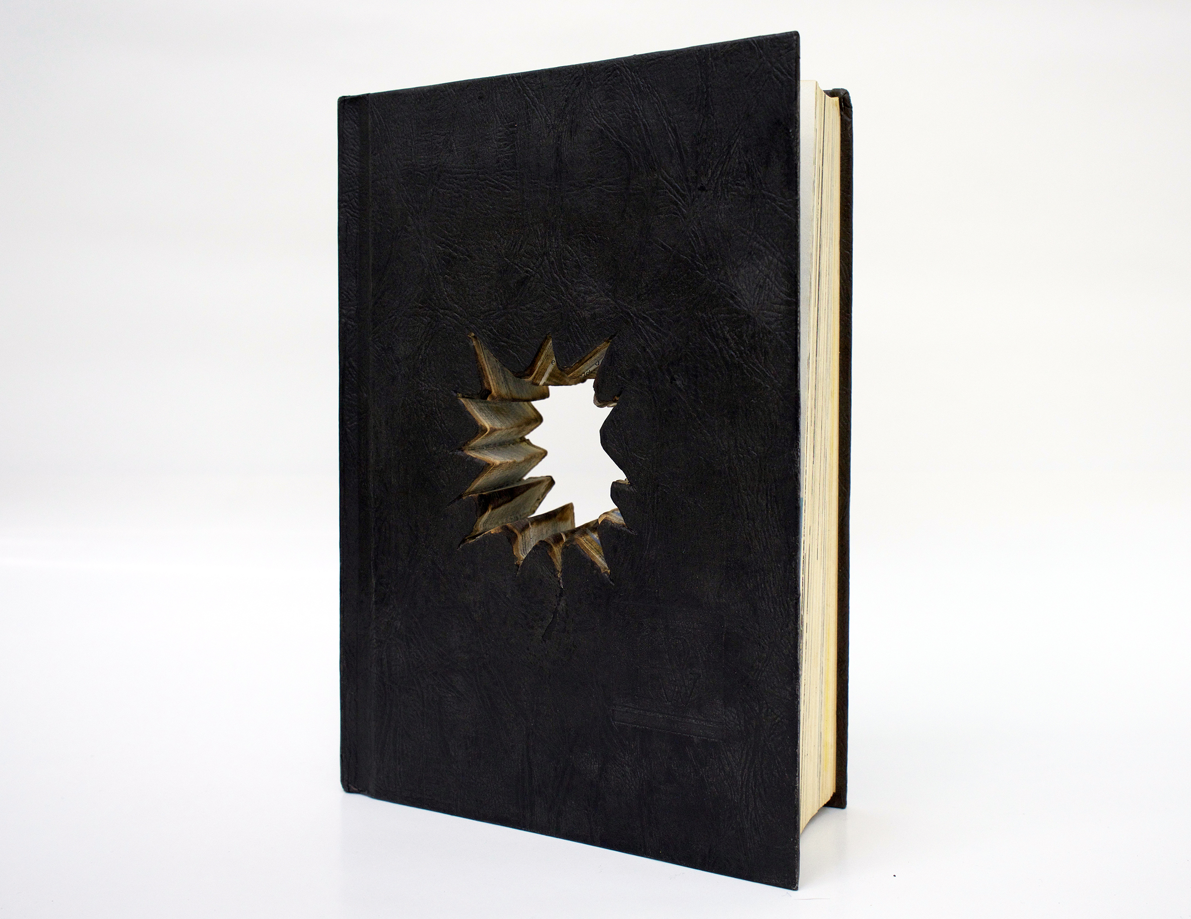 "BESSMA KHALAF  Untitled , 2019 Vintage encyclopedia (paper and binder's board) 9.25"" x 6.5"" x 1.5"""