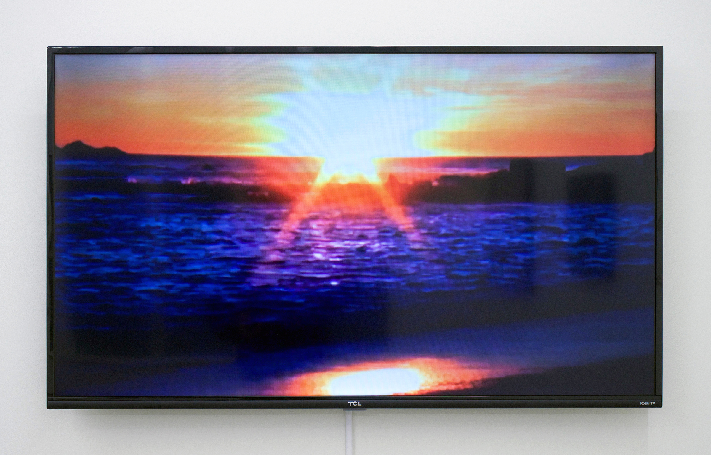 """BESSMA KHALAF  Standing On A Beach , 2015 Single channel video with sound, 2min 9sec lood, 50"""" monitor, Edition of 5 with 1 AP"""