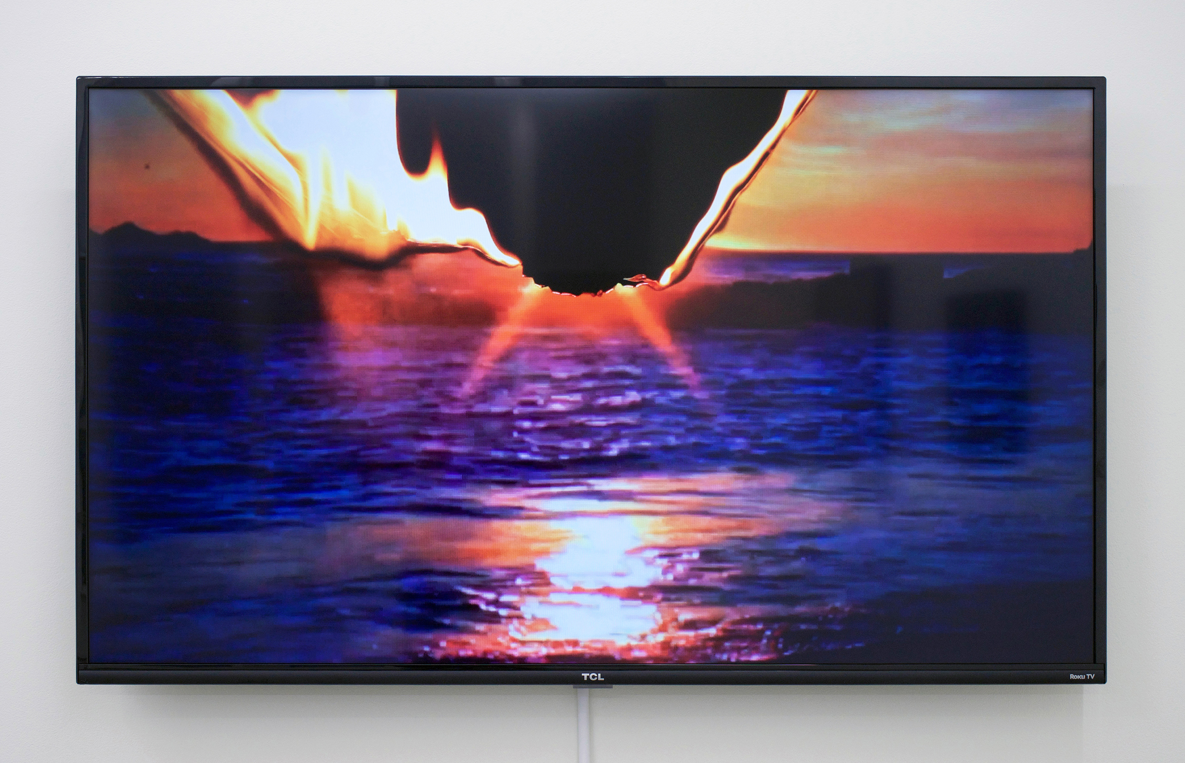 """BESSMA KHALAF (alt. image)  Standing On A Beach , 2015 Single channel video with sound, 2min 9sec lood, 50"""" monitor, Edition of 5 with 1 AP"""