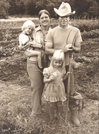 "Here's the family on our very own farm with our big vegetable garden in the background. Our photographer friend, Ken Spencer, put this picture in an exhibit, calling it ""Homesteaders."""