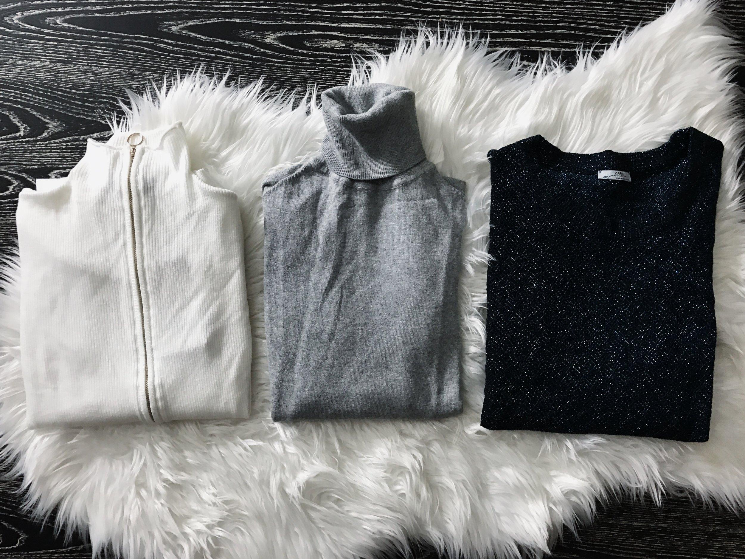 ZARA  White Zip Up; $12.99; Grey Turtleneck $9.99; Metallic Sweater; $9.99 similar  here,   here , &  here.