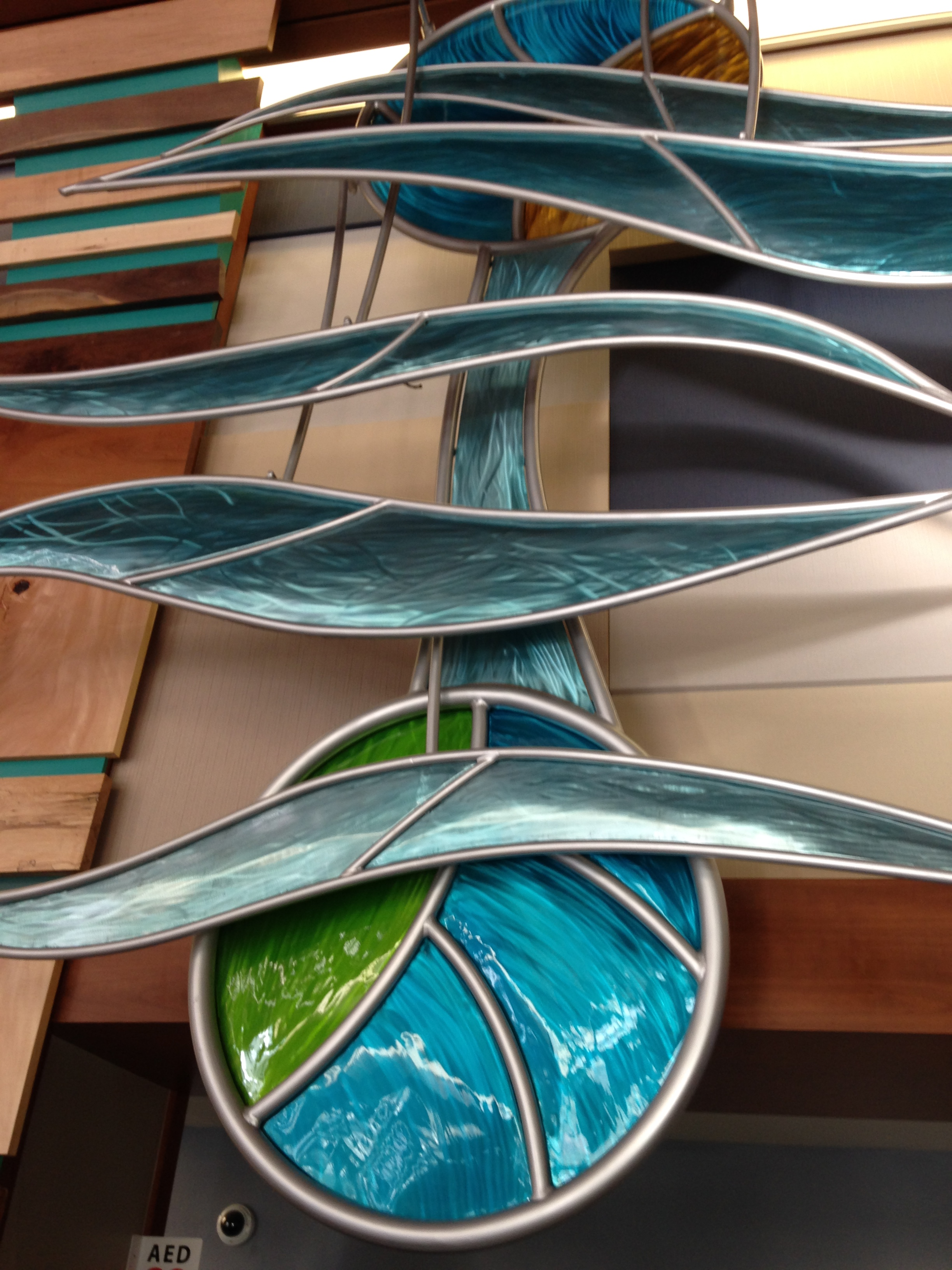 Earth, Sun and Waves , Above Emily Griffith School entrance.  Set it waving