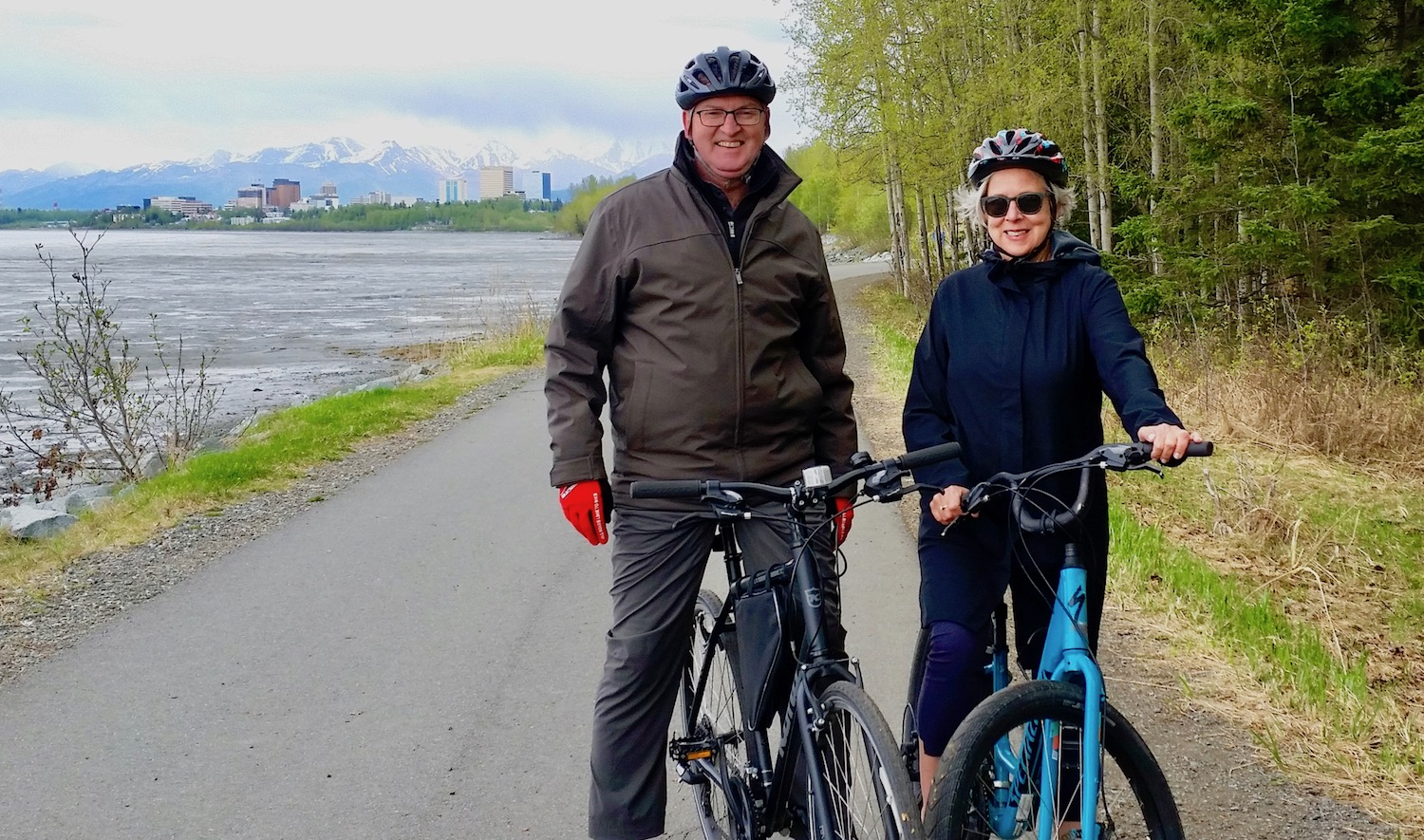 Senior couple on Tony Knowles Costal Trail bike tour Anchorage view