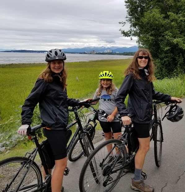 Parents and child enjoying Tony Knowles Coastal Trail bike tour