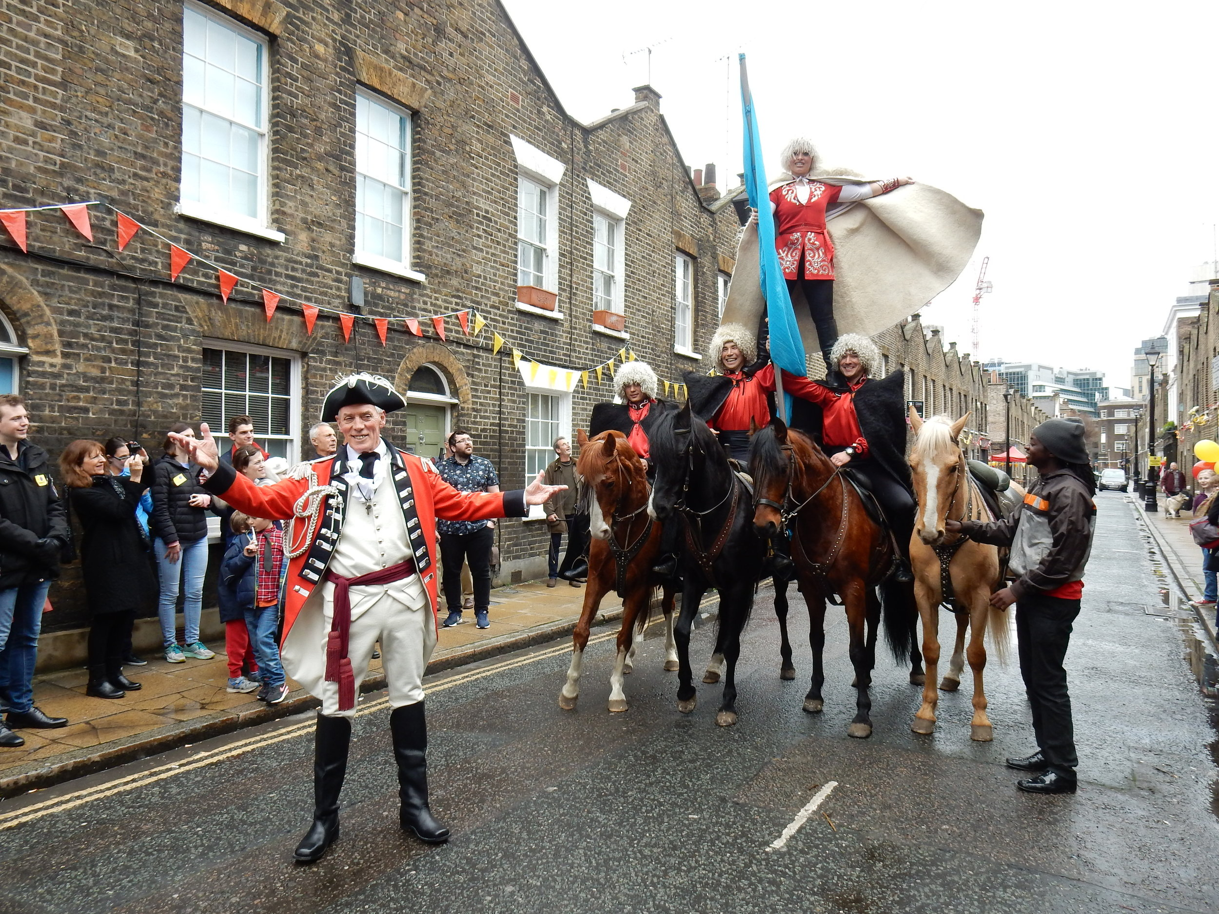 Easter Monday 2018.  Roupell St, Waterloo - the site of Astley's Ha'penny Hatch. Chris Barltrop as Philip Astley, accompanied by the Khadikov Riders from Zippo's Circus.