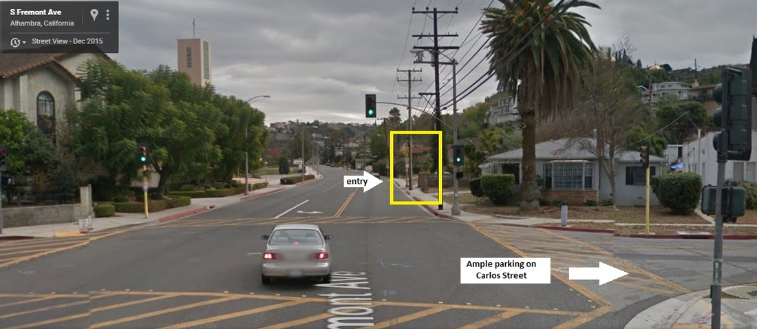 Street view of parking on CARLOS ST