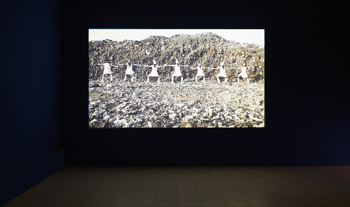 Tejal Shah,  Landfill Dance (Channel II) , part of the larger multi-channel video installation  Between the Waves , 2012, courtesy of the artist and Project 88, Mumbai. Photo courtesy of the Dhaka Art Summit and Samdani Art Foundation.Photo credit: Jenni Carter
