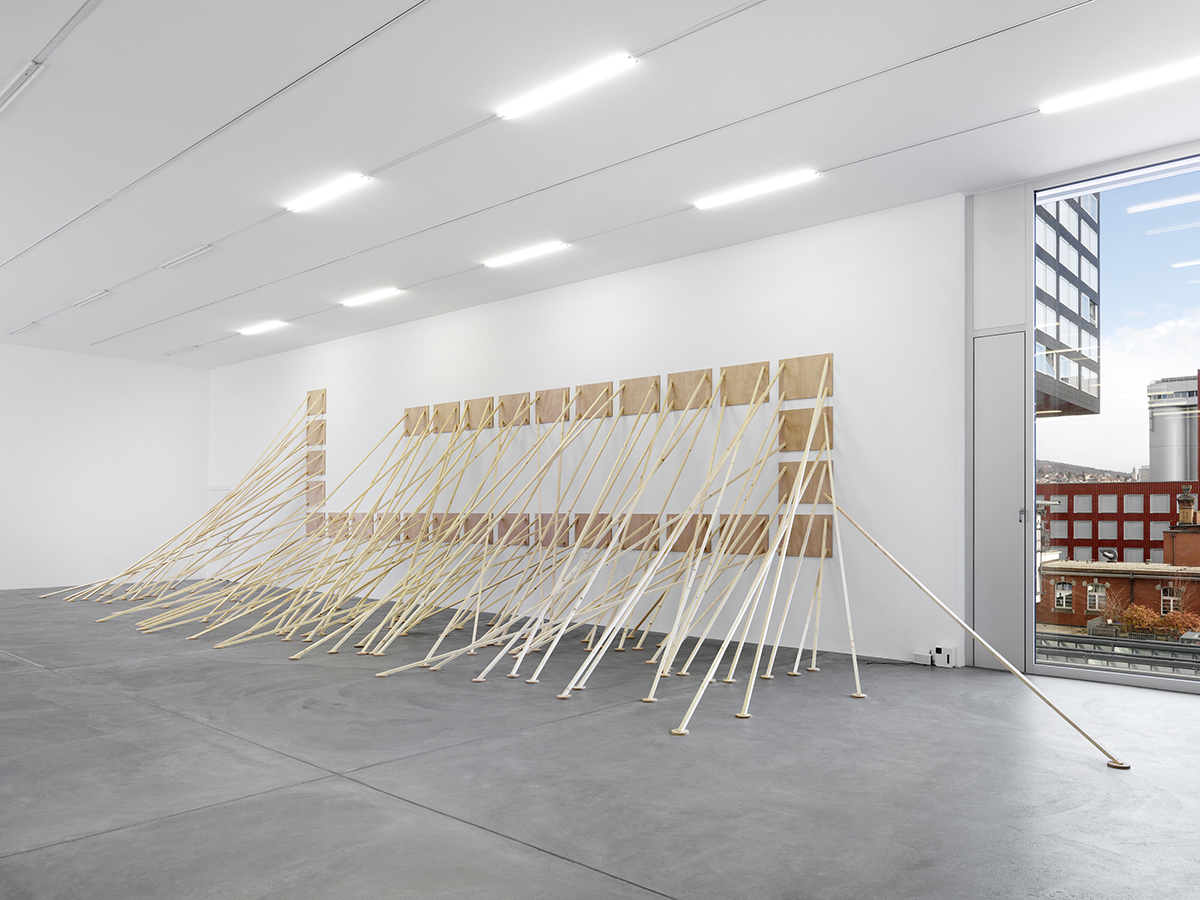 so-so sits on the park bench and observes the trees blowing in the breeze,at peace  (2017), wood, various dimensions, on display at 'Speak, Lokal', Kunsthalle Zürich. Image courtesy: Annik Wetter