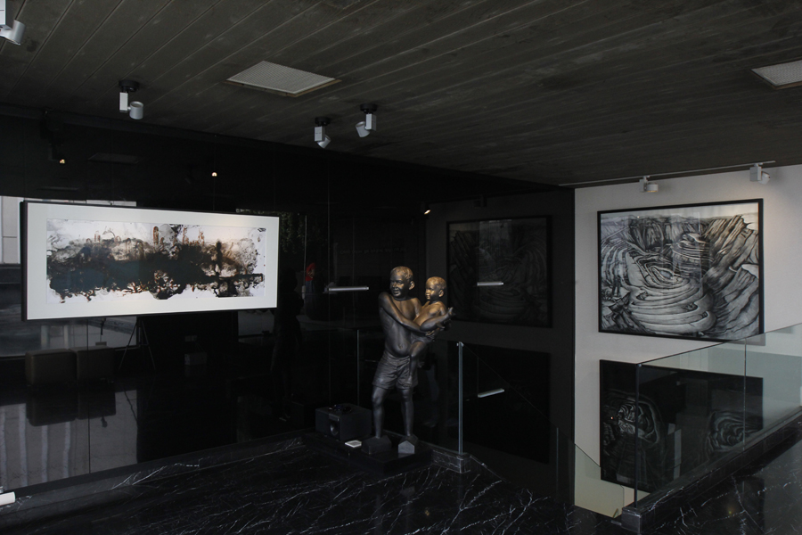 (Left) Philippe Parreno, Abandons Its Own Territory, Goes Beyond Its Borders , 2014 / (Centre) Jitish Kallat,  Hypotenuse , 2008, (Right) Prabhakar Pachpute,  Dust Bowl In Our Hand , 2013. Courtesy of the Samdani Art Foundation. Photo credit; Noor Photoface