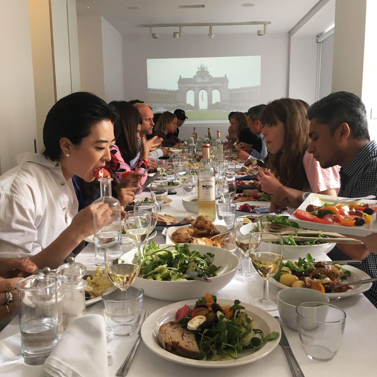Mizanur Rahman Chowdhury at a Delfina Foundation dinner with other artist residents.  Image courtesy of the Chowdhury.
