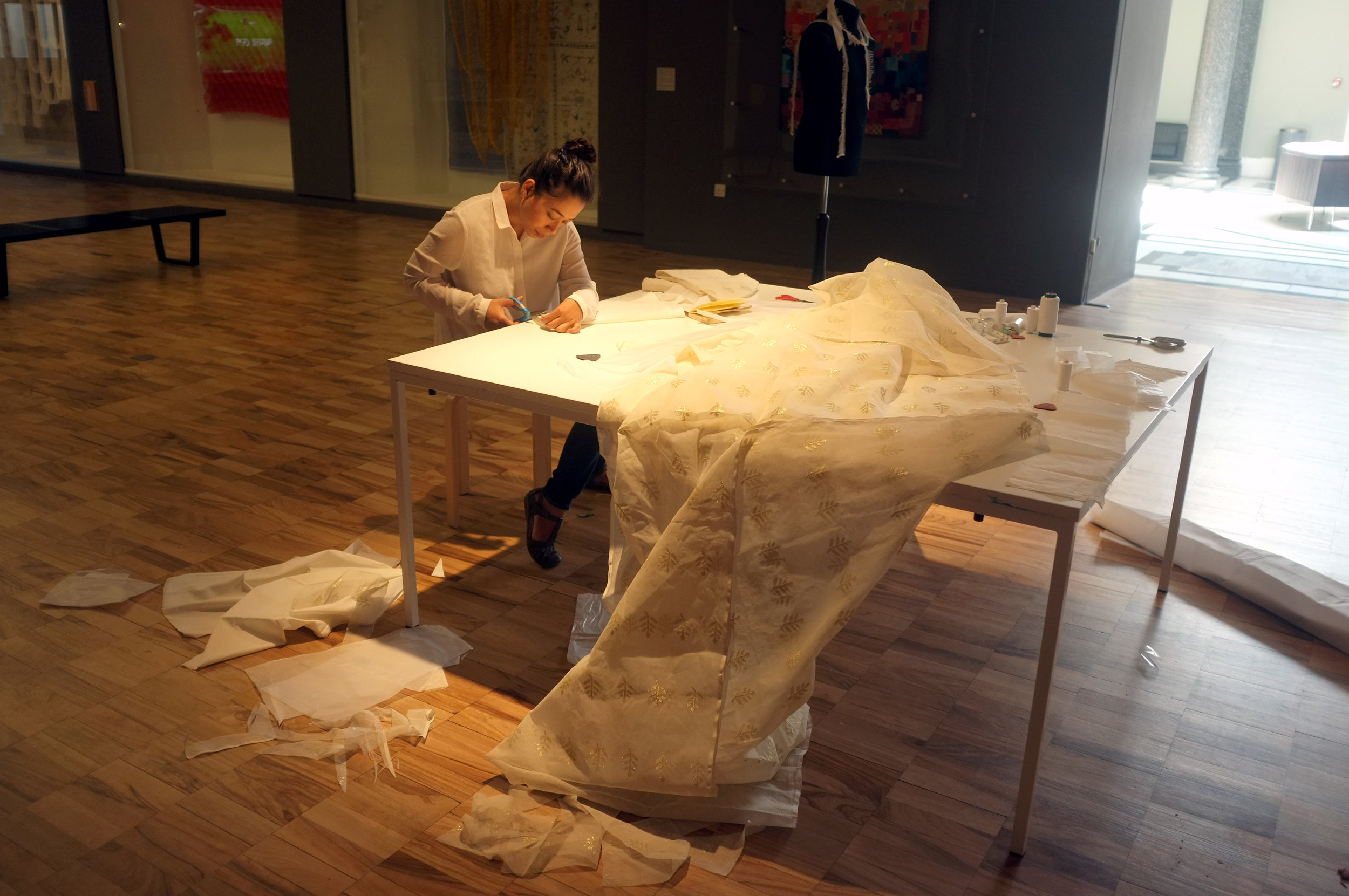 Performance Still of  A Tailor is sewing the dress of Tipu Sultan  (2018). Photo courtesy: Ashley Van Dyck and Whitworth, the University of Manchester.