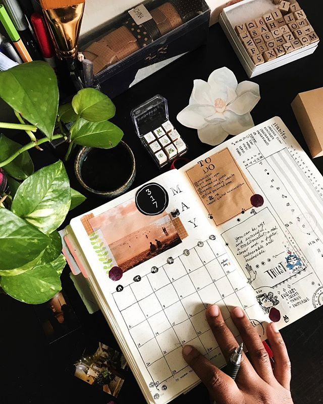 I've kept a journal since I was 13 〰️ But around 2 years ago I started incorporating bullet journal spreads between art explorations and life documentation.  Beyond helping me build a solid daily routine 〰️ my creative output has soared. Its allowed me to intentionally plan my days and weeks to align with meaningful goals, while also curating positive habits that encourage growth 🌿. It's also nice to have a place to house the low-key engagement photos @cloudrtist and I took 💕 This is one of my favorites taken by @spacelovemelody 🍃  #bujo