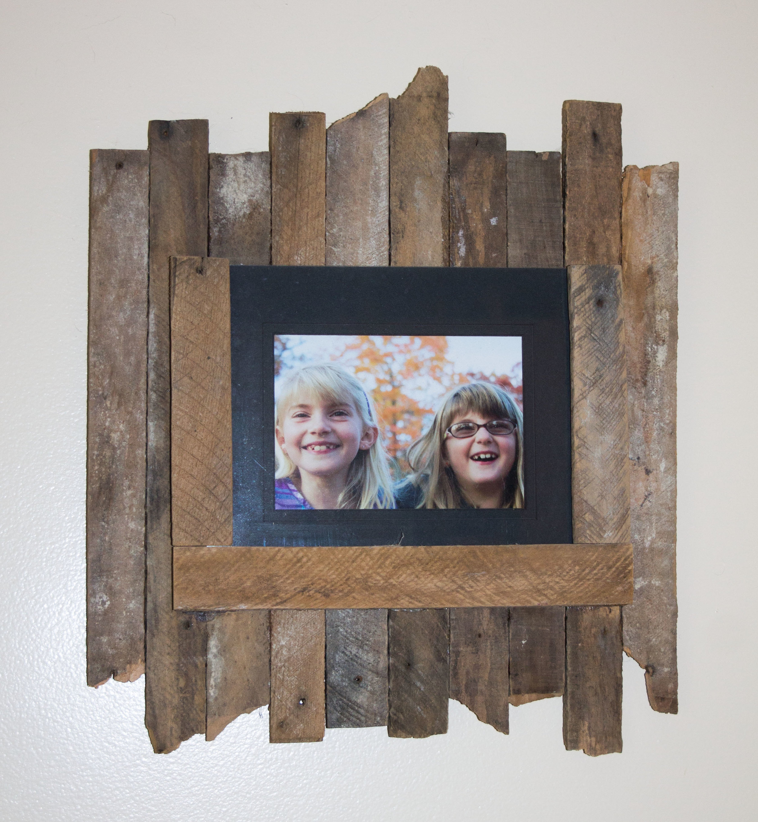Photo frame made from plaster lath strips.