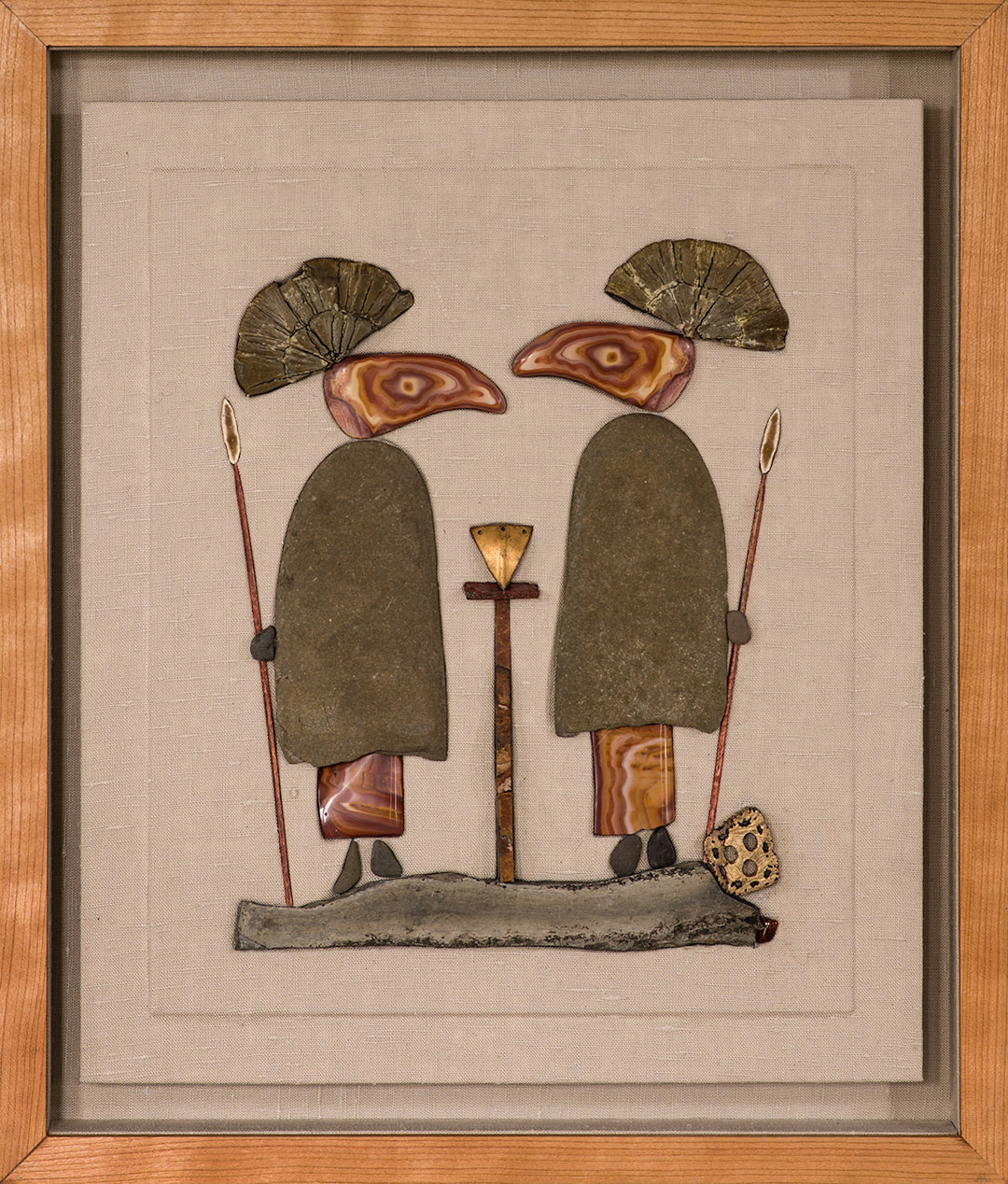 """THE PERENNIAL GOOD GUY and BAD GUY   This piece is no longer available  Stone, wood, flint, pyrite suns, wonder stone and linen in a lined cherry shadow box.  (19"""" x 16 1/4"""")"""