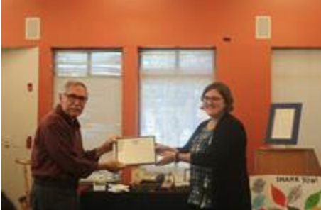 Friends of East Atlanta Library Pres. Mike Pousman with volunteer coordinator Heather Staniszewski. Photo by Marcy Meyers