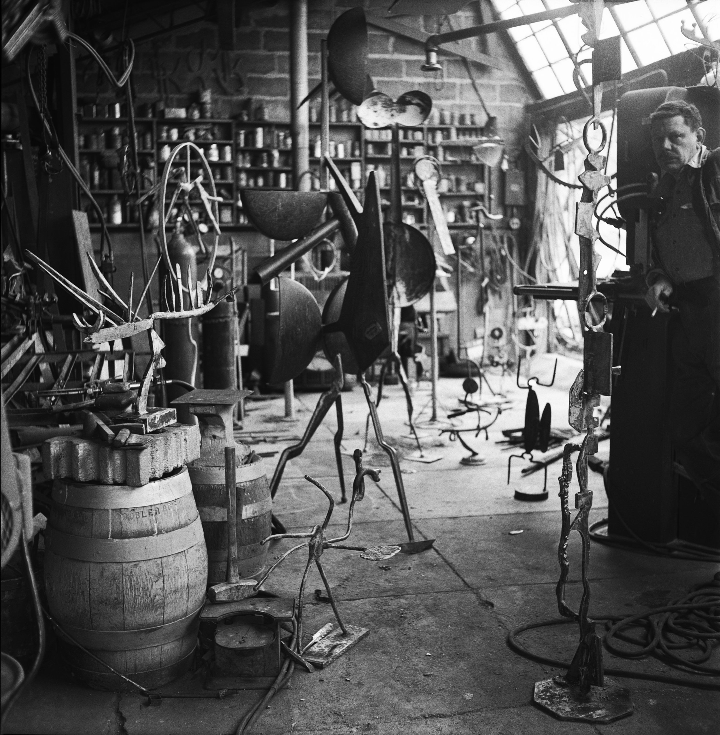 David Smith in his workshop, Bolton Landing, 1953. Photograph by the artist. © The Estate of David Smith/Licensed by VAGA, New York.