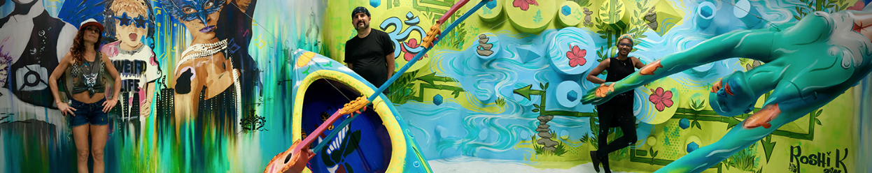 Artists pose with the completed Austin piece: Keeping Austin Weird.