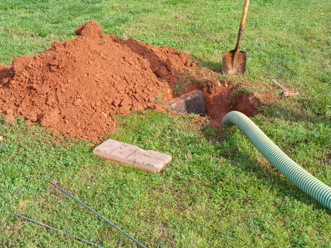 A septic system being serviced