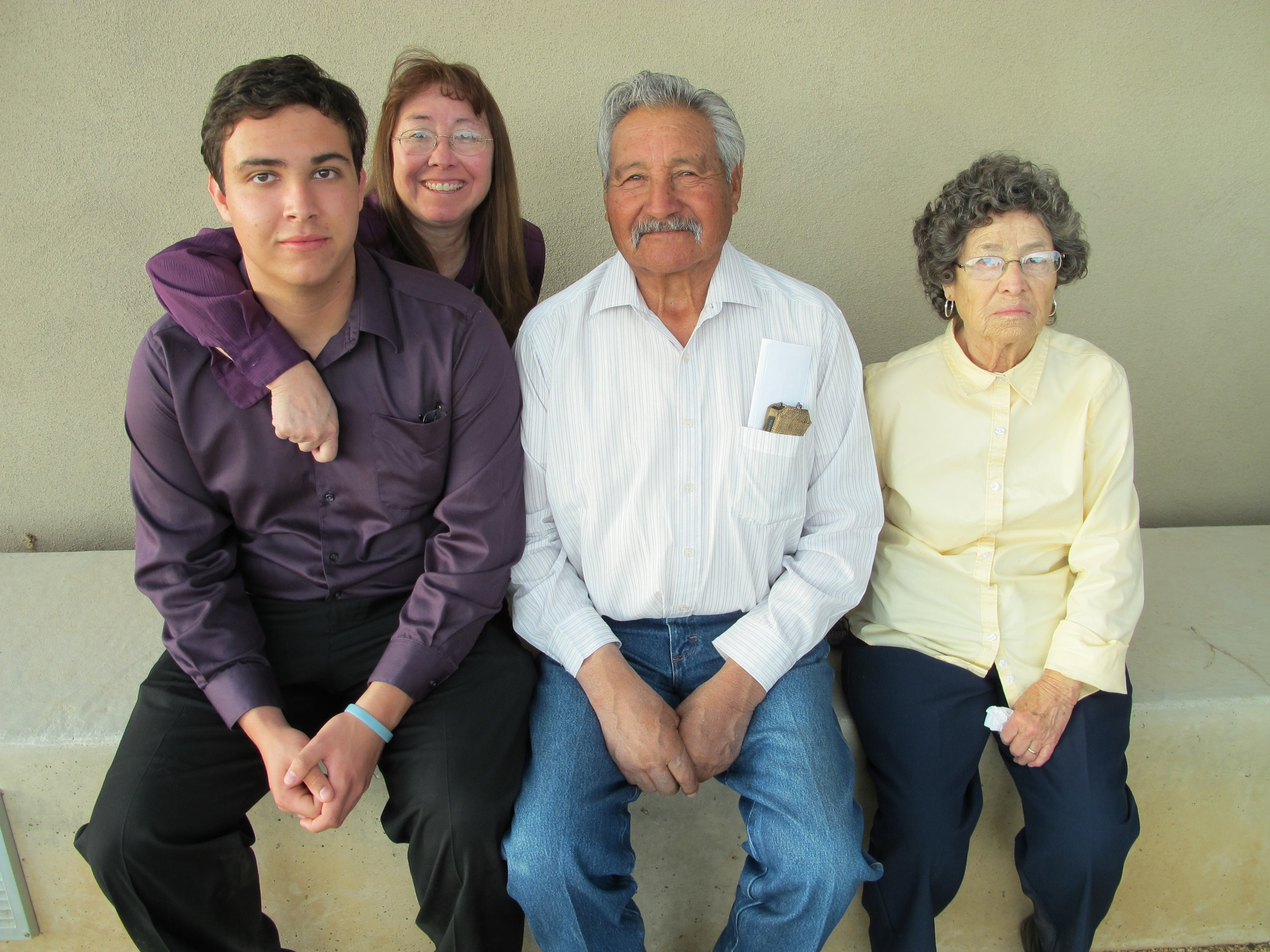 Photo of Matthew Lassey and family. Matthew was the overall best essayist in the 2013 Aldo Leopold Writing Contest
