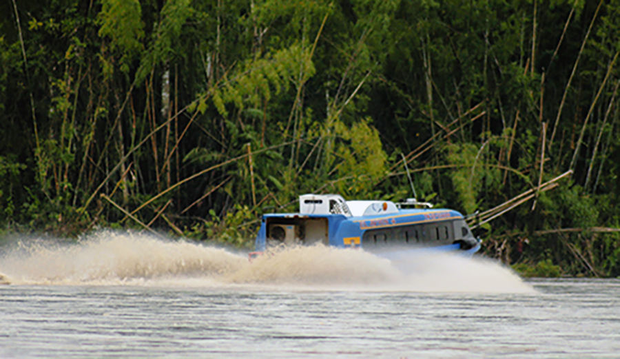 A high-speed passenger boat carries oil-company employees up the Napo towards the Yasuni area.    (Sierra   Bilton)