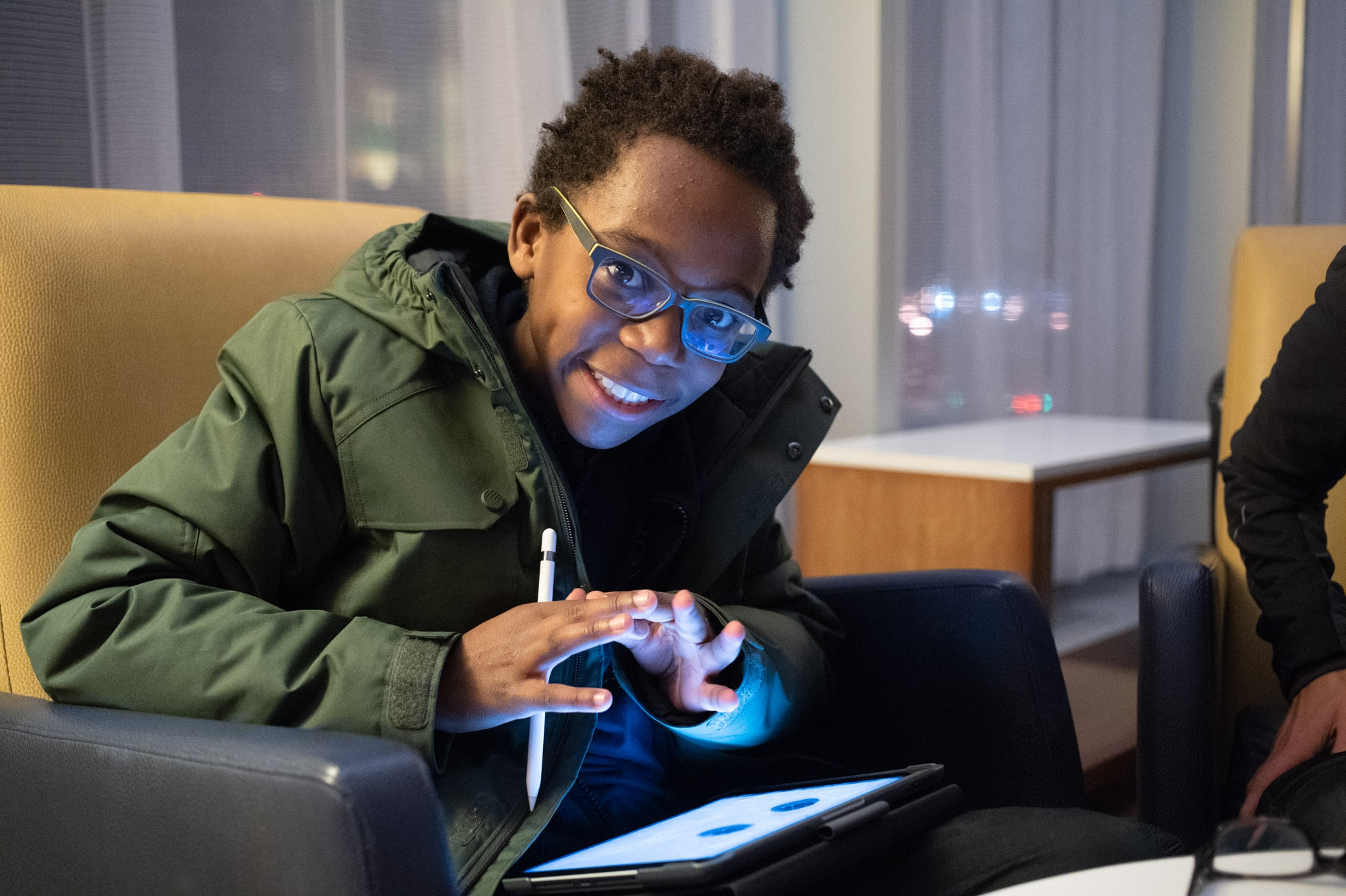 Most recent picture of my son Henri, all smiles with his best friend Sylvie Ouellette's new IPad at the Marriott Montreal Airport November 23, 2018. Sony A7III 1/100 F2.8 12800 iso