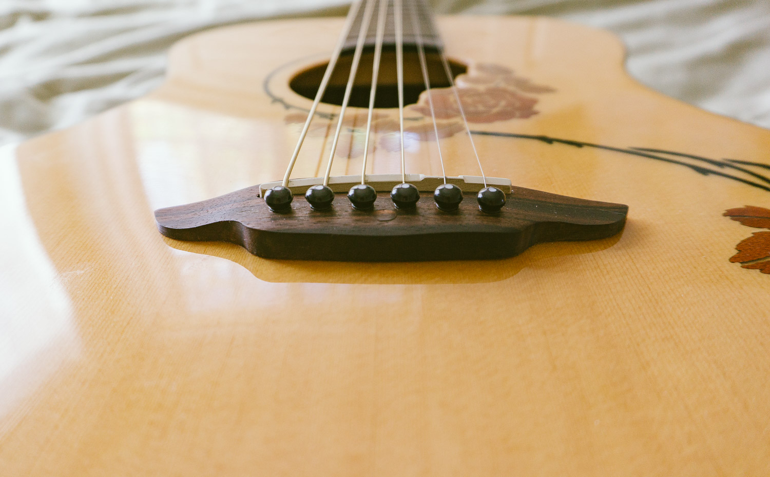 I actually don't know how to play the guitar (yet) ... but I can restring one.
