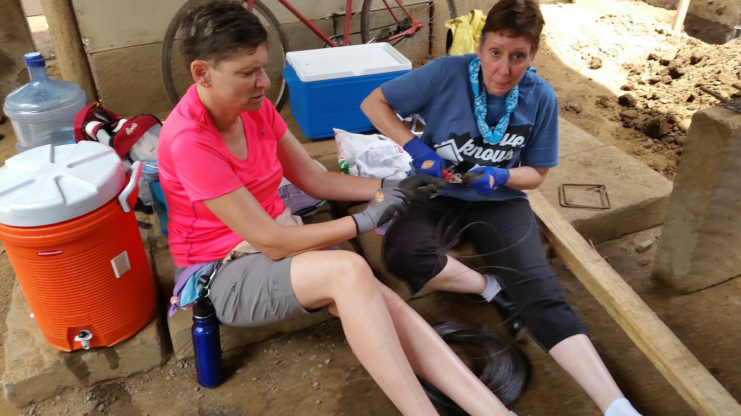 Gwenna and Debora cutting wire.