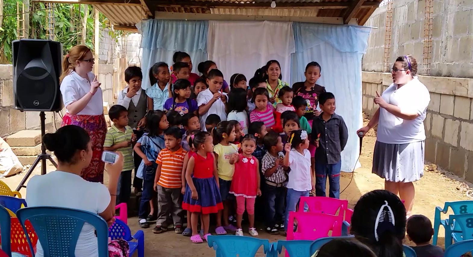 "The children sing ""Esta Lucecita"" (This little light) during worship."