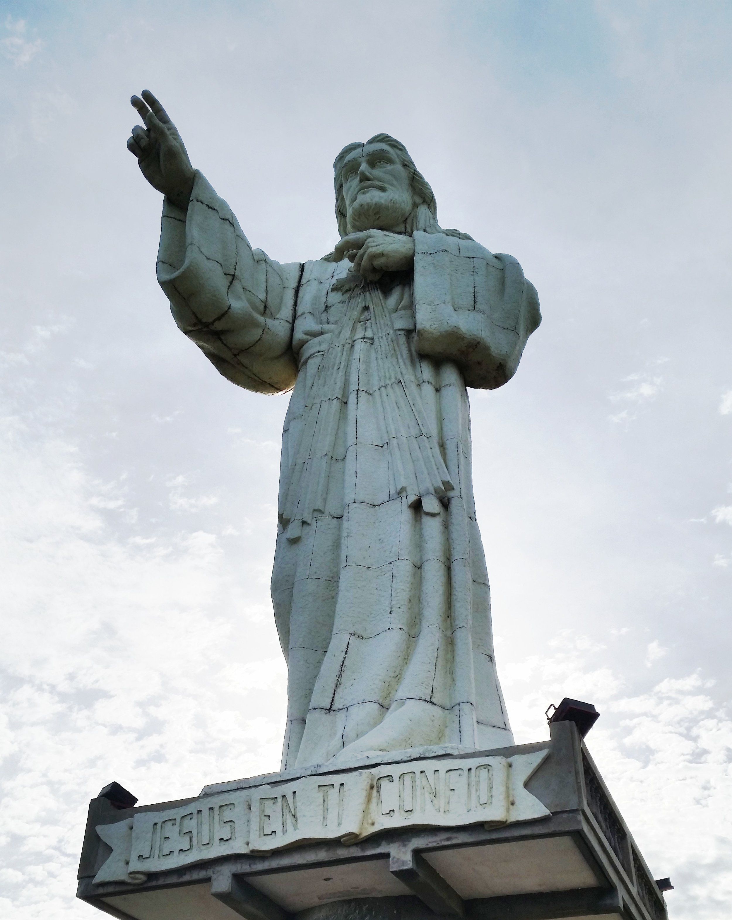 The Christ of Mercy Statue (the inscription translates to Jesus I Trust in You)