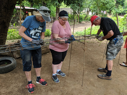 Sue, Geraldine and Don Vickers work on constructing rebar.