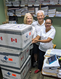 Sue and Conrad present four medipaks containing vital medicines to an administrator at La Mascota hospital in Managua, Nicaragua. Las Mascota hospital treats children with cancer.    For more information on Health Partners International Canada visit: www.hpicanada.ca.
