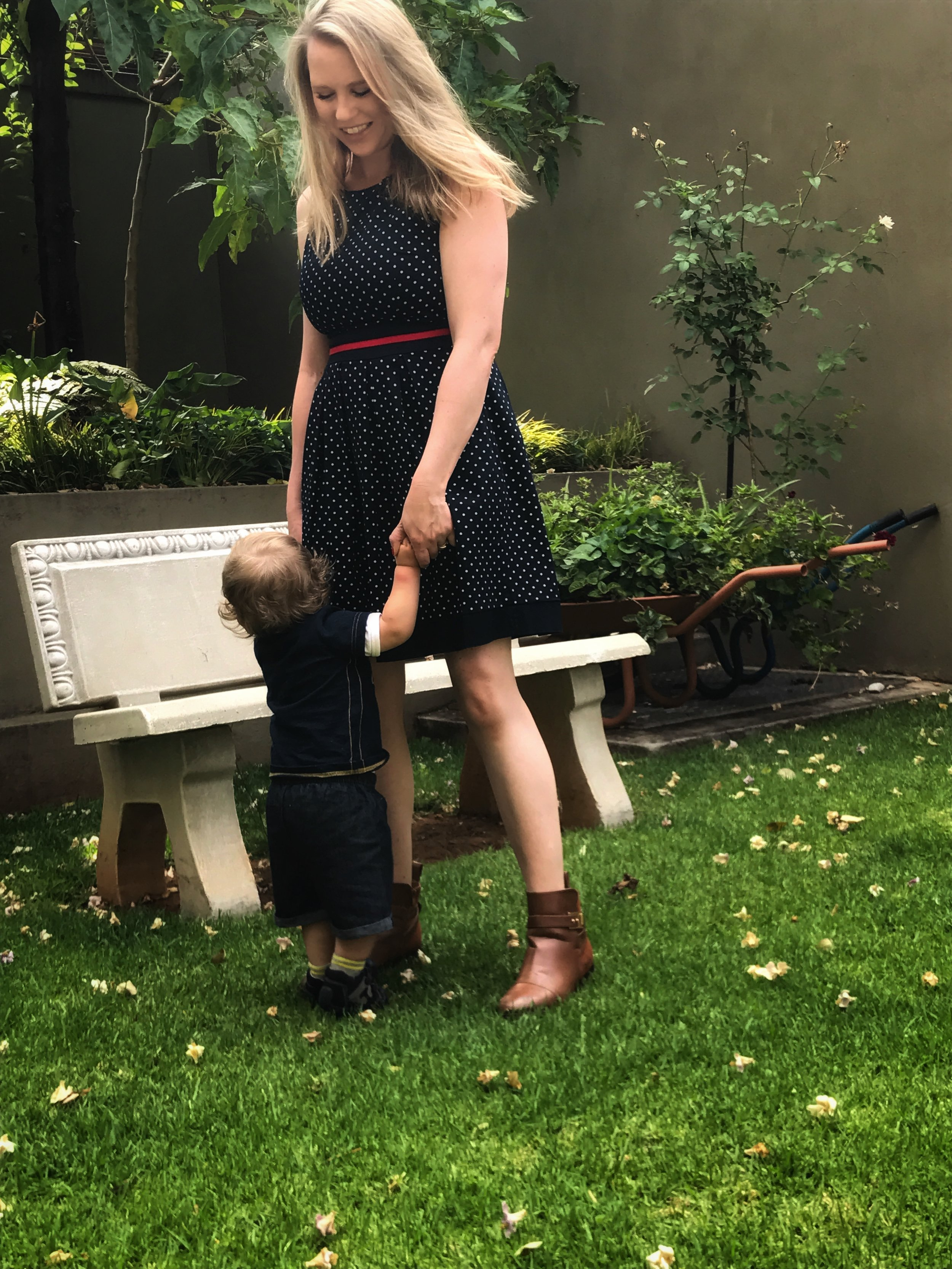 Erin is wearing a dress from a vintage store she found on one of her travels to Italy and boots from Steve Madden.