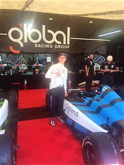 jacob under global team  tent standing near f4 car.JPG