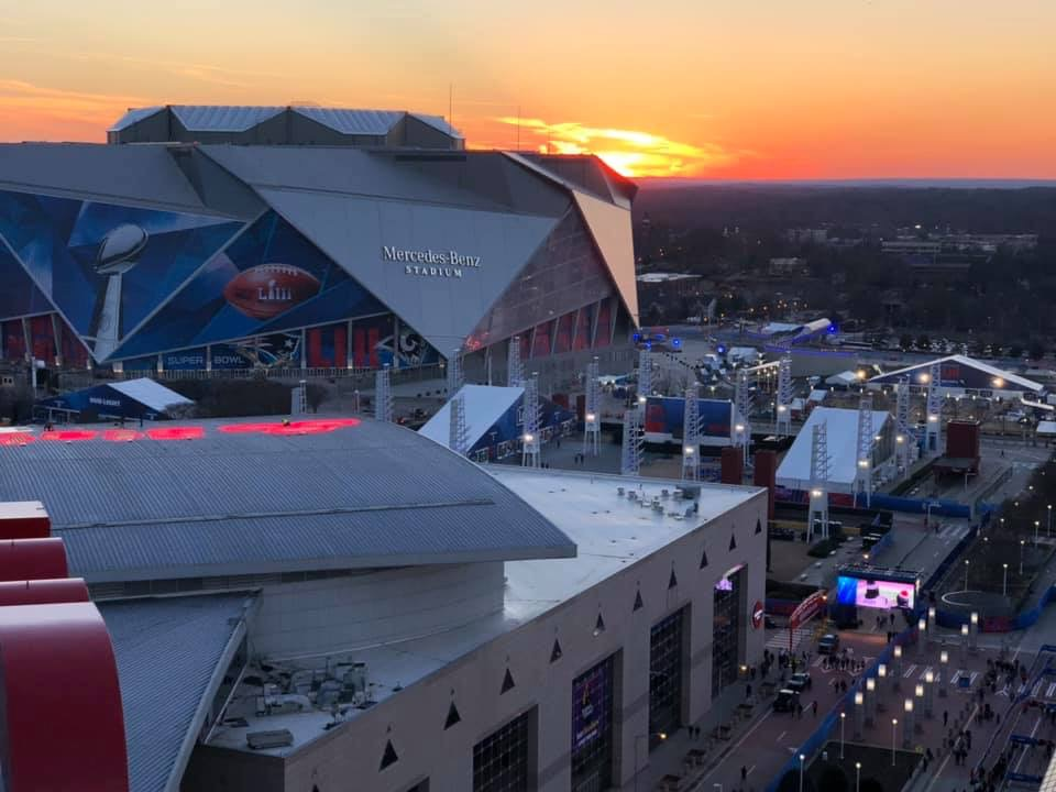 Mercedes-Benz Stadium during sunset, from the roof of Georgia World Congress Center.