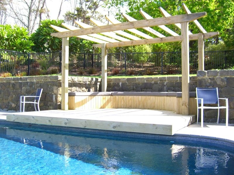 (8) Natural rock retaining wall with pool fencing