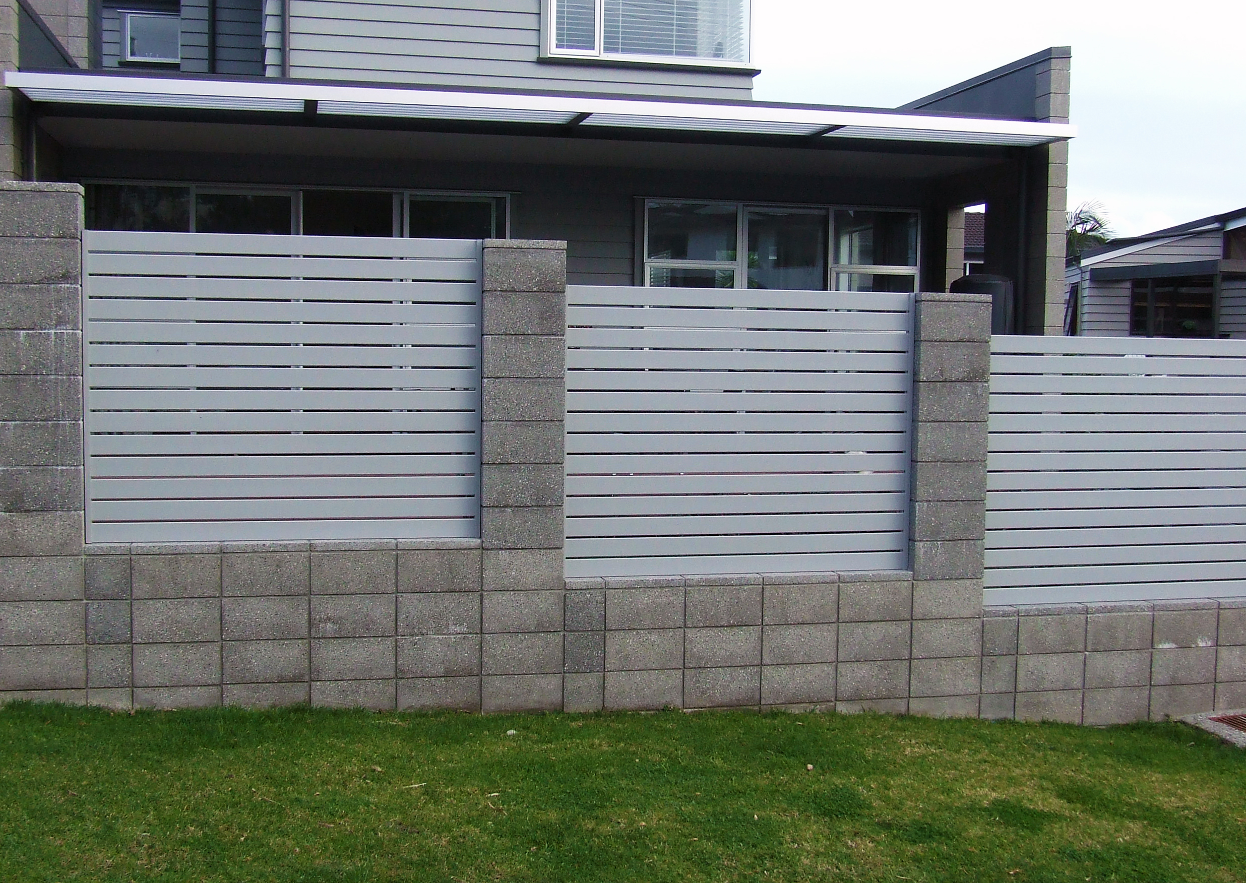 (19) Slat panels with honed block wall
