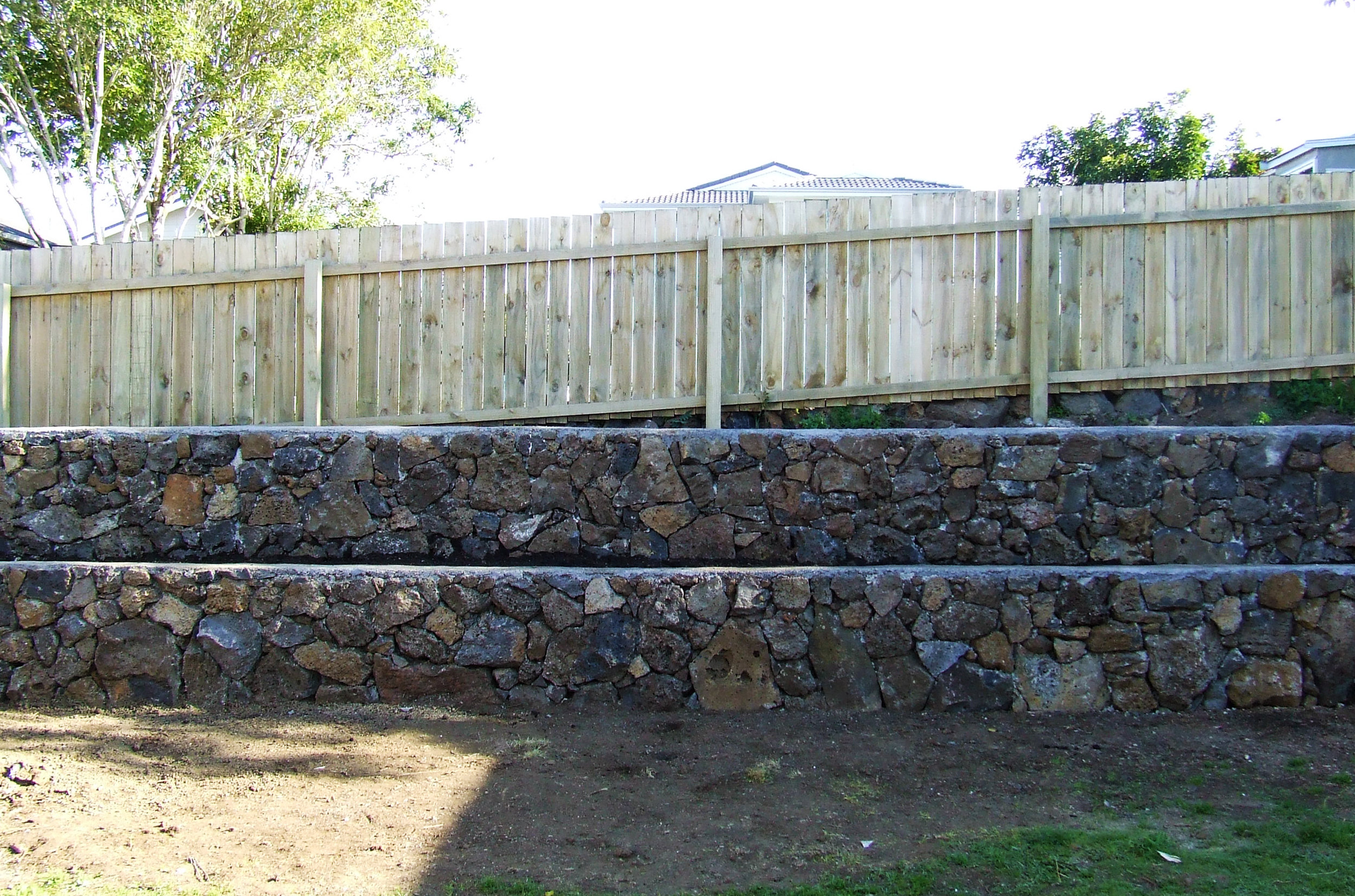 (20) Natural rock retaining wall with timber fence