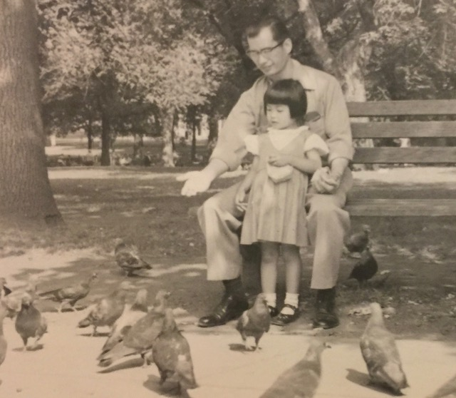 Cynthia with her Uncle Eddie, who is teaching her how to feed pigeons in the Boston Common.  Photo Courtesy of Cynthia Yee.