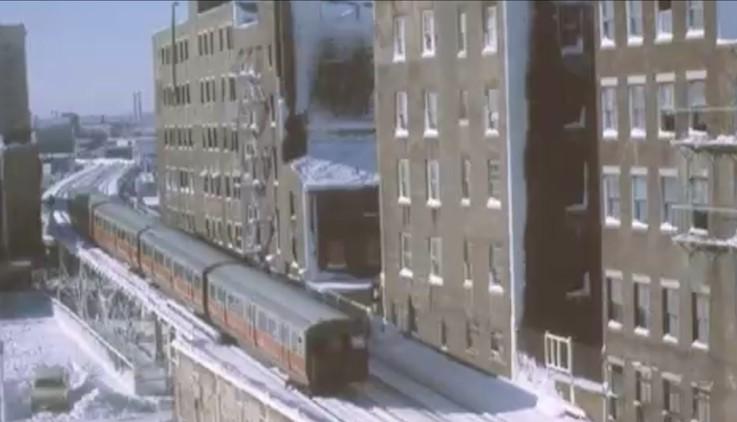 Elevated train running through Chinatown