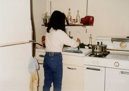 There was no dishwasher, and you can see here that there were only two burners on the stove top.    Cockroaches were all over the apartment, even on the stove tops and sometimes my mother would wake up early in the morning just to kill the cockroaches.