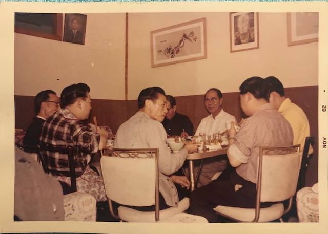 Men's table a birthday party with Cynthia's uncles, dad, and paper brothers; courtesy of the author