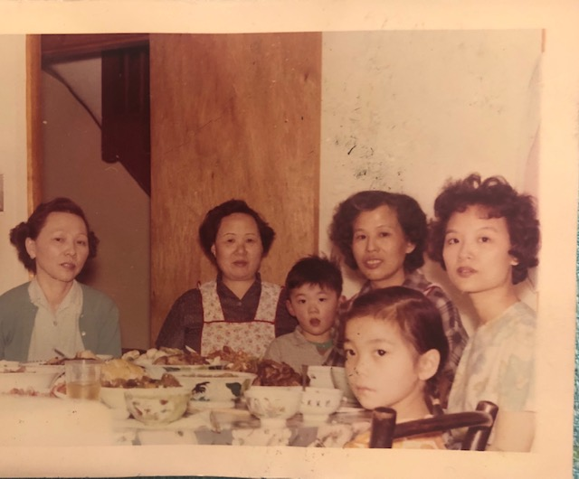Women's table in the kitchen with Cynthia's paper sister in-law, Ah Goo, nephew, mom, niece and Aunty Cheong Sim; courtesy of the author