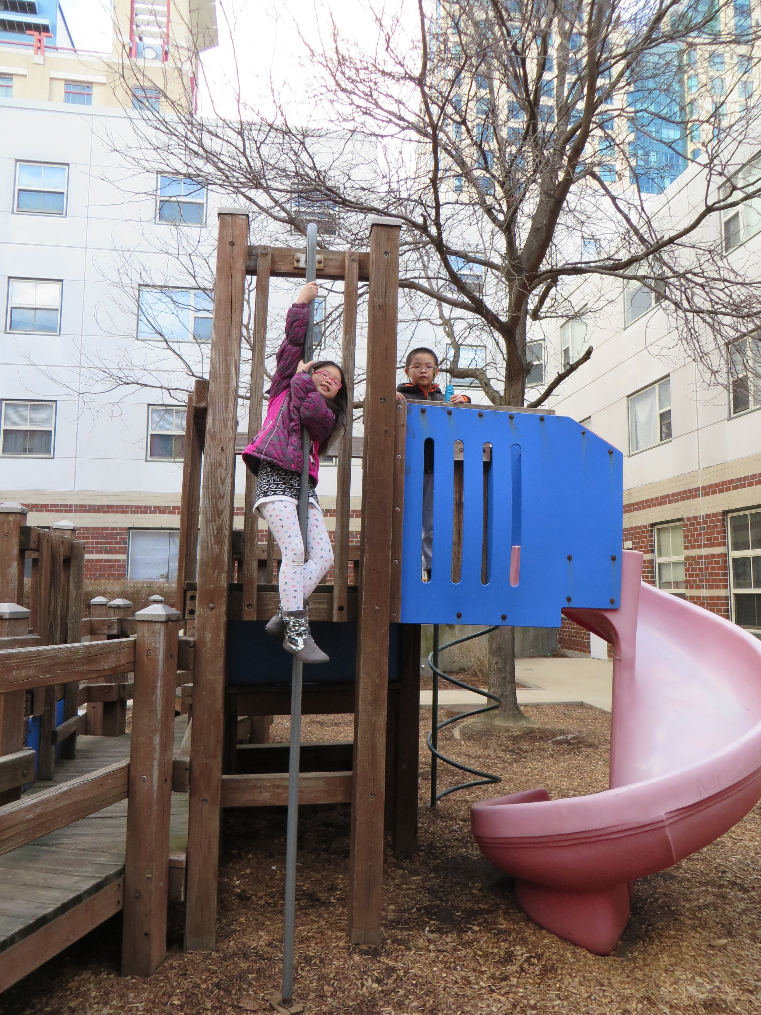 Kids playing on a playground at Oak Terrace