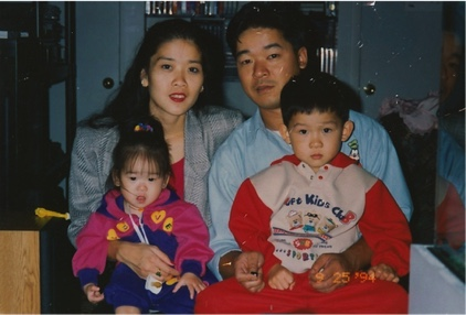 Erica with her parents and brother; photo courtesy of author