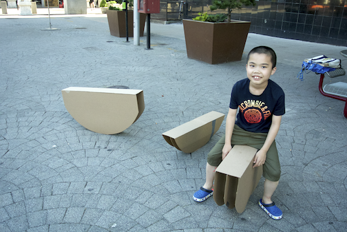 A Chinatown resident tests out one of Ponnapa's pieces for  Sampan installation; photo courtesy of the artist