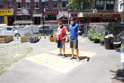 Chinatown residents, Warren (left) and Henry (right) were one of 8 Residence Lab residents who were part of the inaugural cohort. Here they stand proudly by a freshly painted component of  Sampan  in Chinatown; photo courtesy of the artist