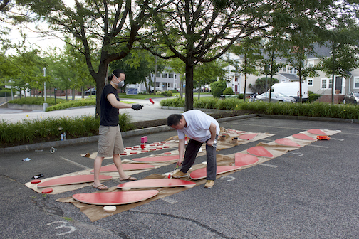 Henry and Warren painting parts for the  Sampan  benches at Sasaki; photo courtesy of the artist
