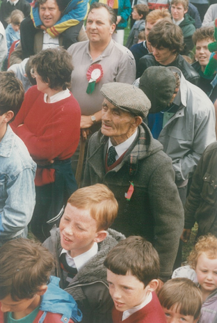 Cashel King Cormac's club president, Willie Ryan (T), (the man with the cap), watching proceedings during the presentation of the cup at Cappawhite.