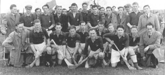 The 1953 Cashel King Cormacs County Junior Hurling Champions, pictured in the old G.A.A. grounds in Tipperary Town prior to their championship game with Solohead.  Front L/R. Mick Coady, Jim Ryan, Johnny Murphy, John Murphy, John Eakins, Mickey Murphy, Denis Hickey, Michael Gayson, Paddy O'Brien, Matty Gayson, Jim Devitt. Back L/R. Tom Devitt, Ger Ryan, Peter Looby, Christy Stack, Steedy Morrissey, Billy Hickey, Tom Twomey, Michael Davern, Monto Carrie, Dick lvors, Tommy Joy, Edger Morrissey, Michael Ryan, Tommy Prendergast.